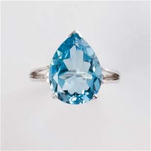 A blue topaz, diamond and fourteen karat white gold