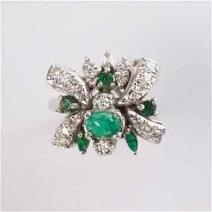 An emerald and ten karat white gold ring