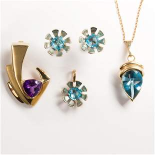 A group of blue topaz or amethyst jewelry