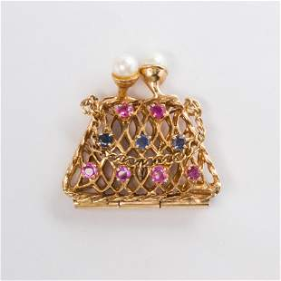 A Retro gemstone and fourteen karat brooch and charm