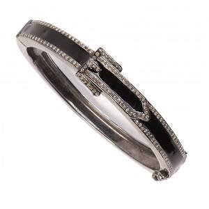 A diamond and enameled blackened silver bangle