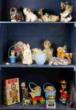 Three shelves of antique stuffed animals and toys