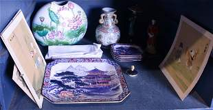 Two shelves of Chinese porcelain and decorative items