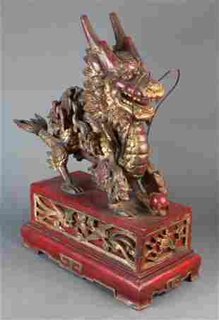 Chinese gilt wood carving of a dragon