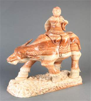 Chinese stone carving of a boy on a buffalo