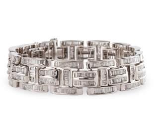 A diamond and fourteen karat white gold bracelet