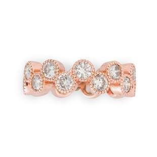 A diamond and eighteen karat rose gold band ring