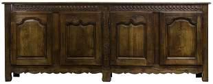 A Louis XV carved oak sideboard