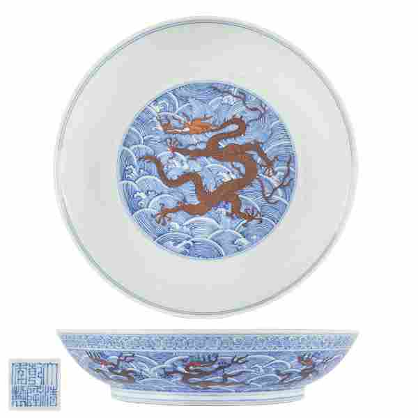 Chinese iron red enameled blue and white dragon dish