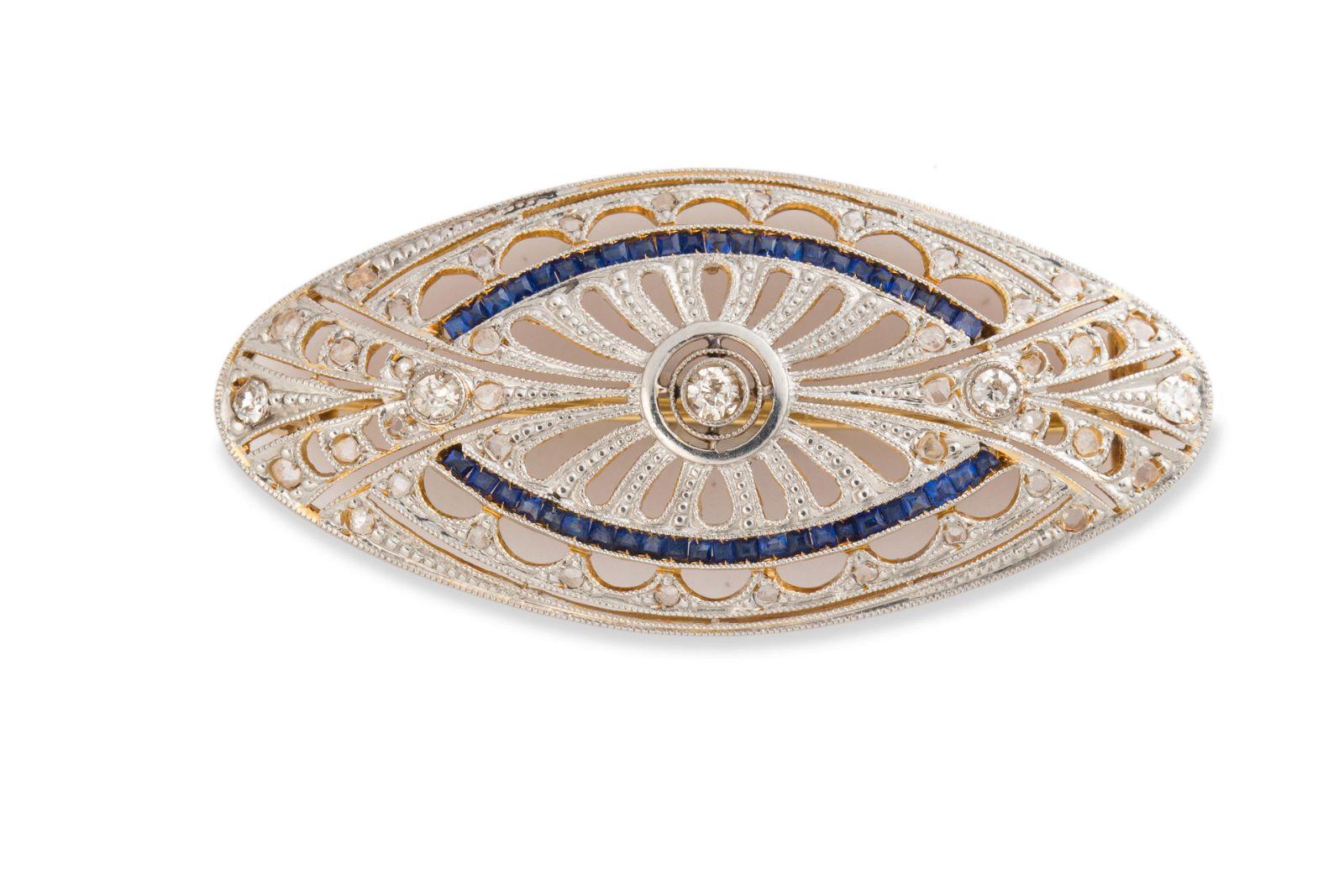 An Art Deco diamond, sapphire and twelve karat gold