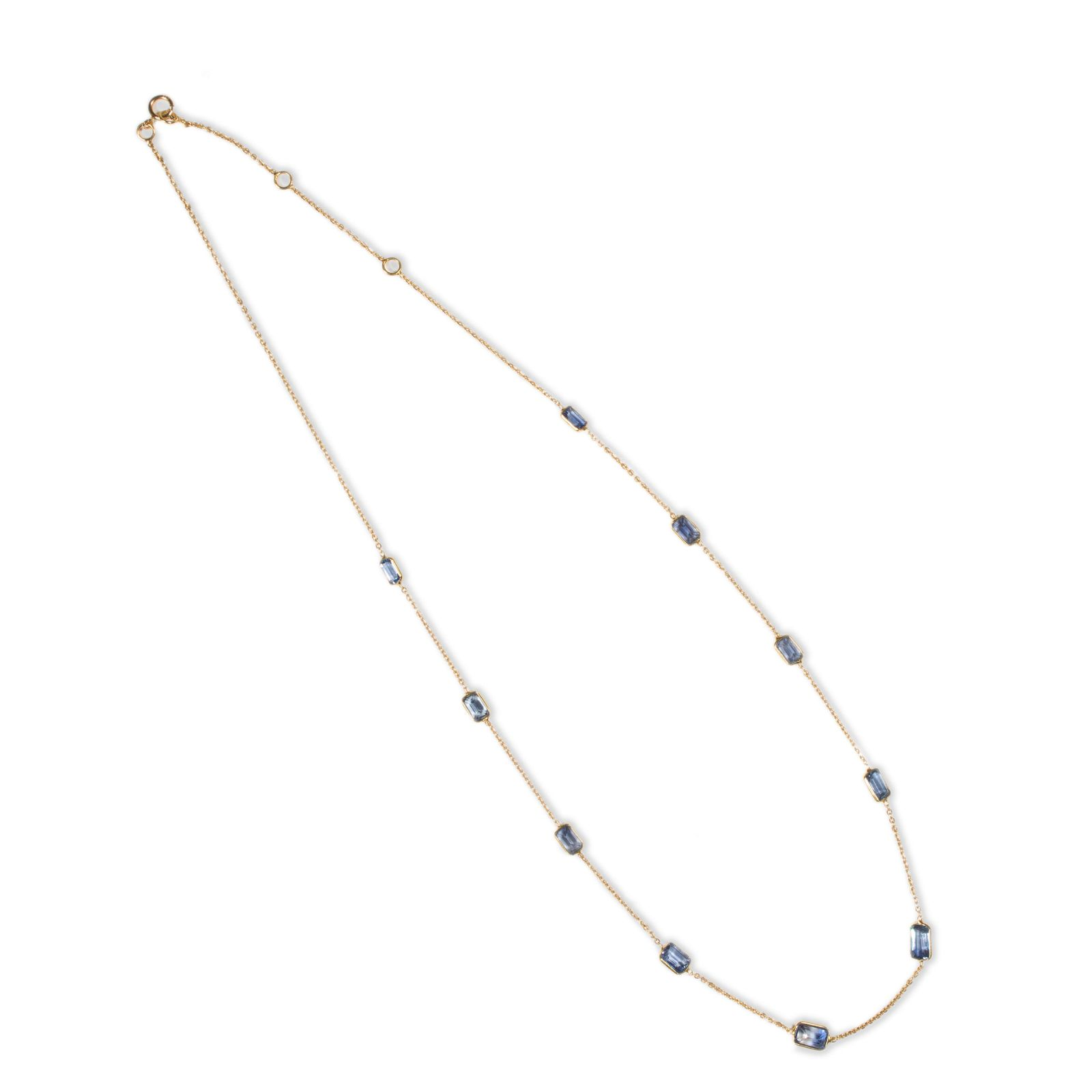 A sapphire and eighteen karat gold necklace