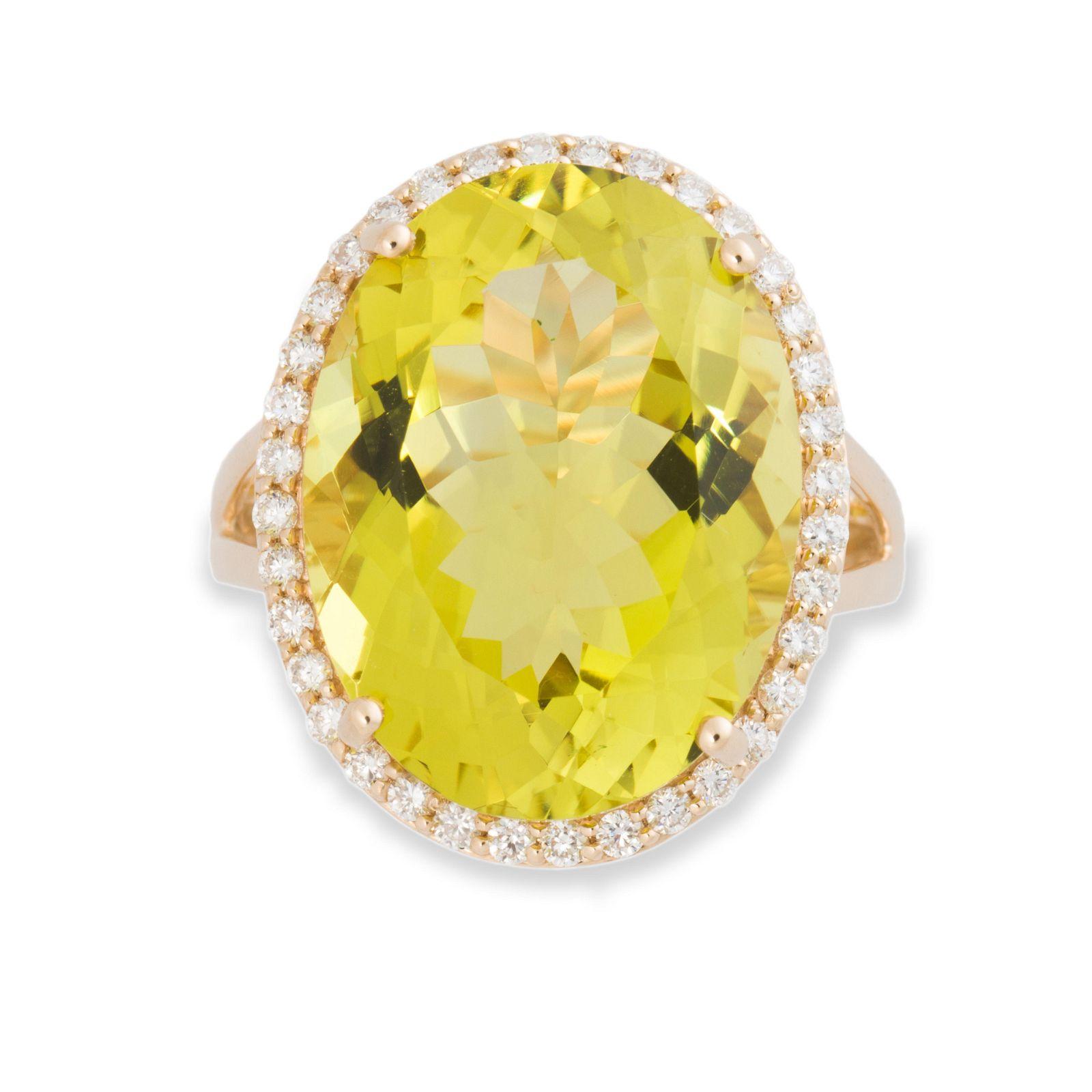 A green quartz, diamond and fourteen karat gold ring