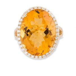 An orange quartz, diamond and fourteen karat gold ring
