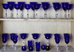Two shelves of cobalt cut to clear goblets