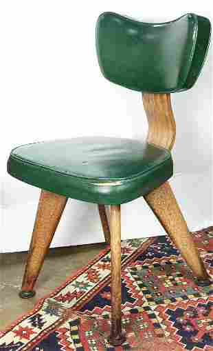 A Modern green vinyl side chair
