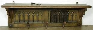 A Gothic Revival oak coat rack