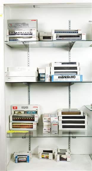 Four shelves of boxed Marklin model trains