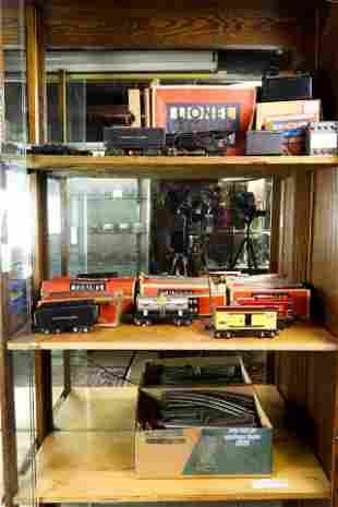 Three shelves of boxed model trains