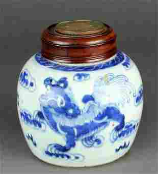 Chinese blue and white ginger jar with a wood lid