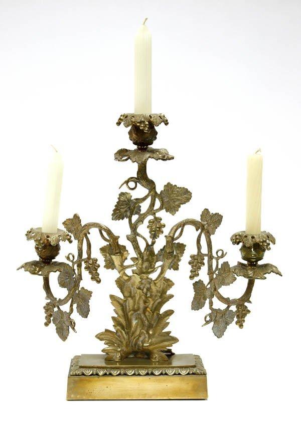2023: Gilt metal 3-light candelabra