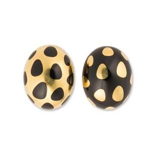 A pair of black jade and eighteen karat gold earrings,