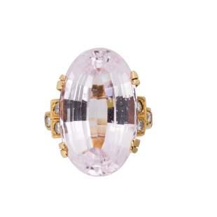 A kunzite, diamond and fourteen karat gold ring