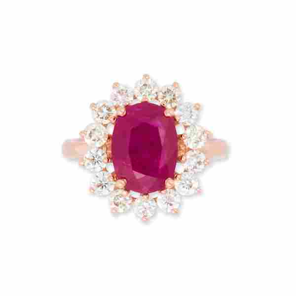 A ruby, diamond and fourteen karat rose gold ring