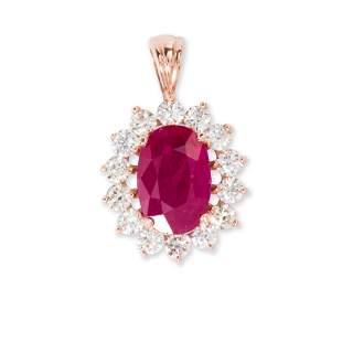 A ruby, diamond and fourteen karat gold pendant