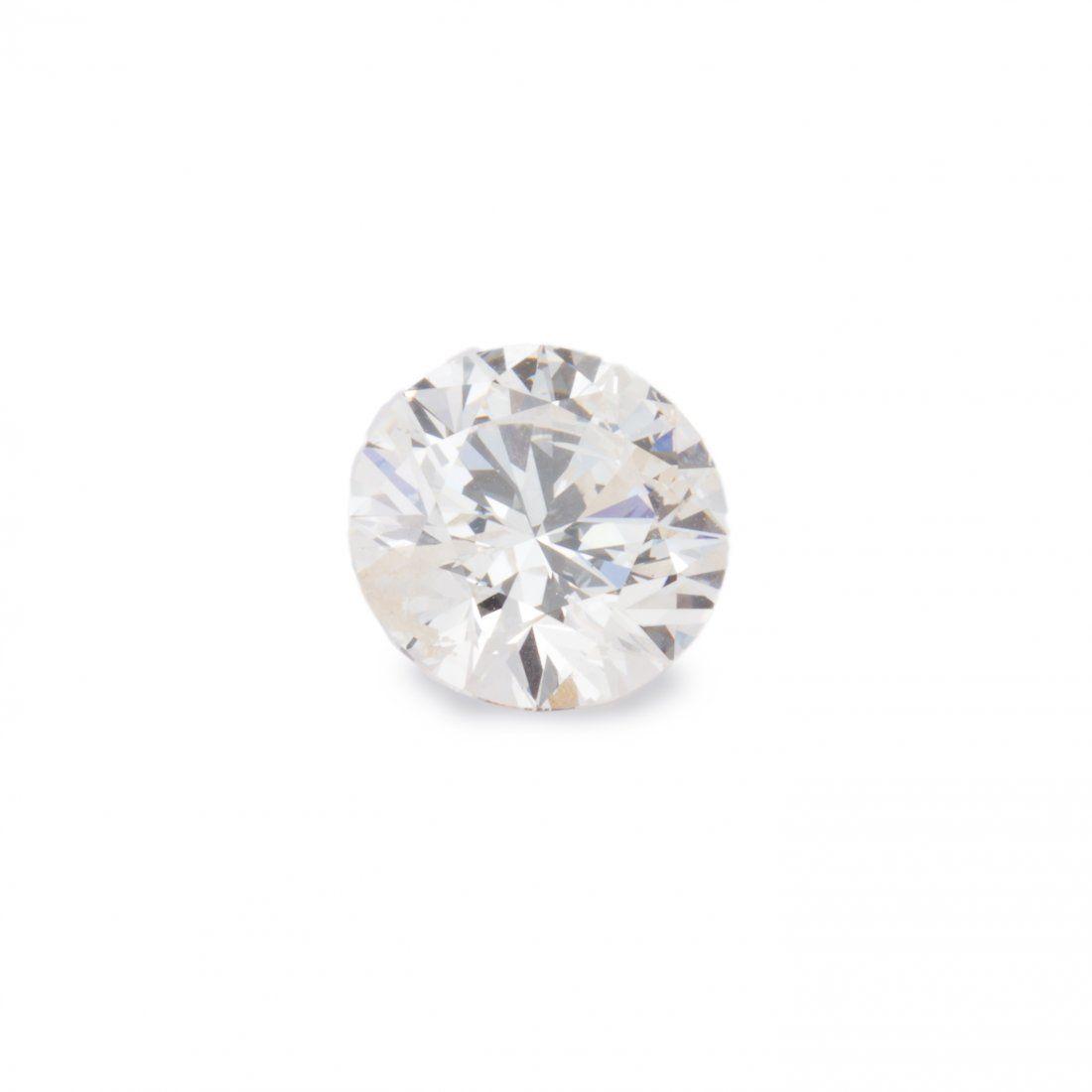 An unmounted diamond and fourteen karat gold ring