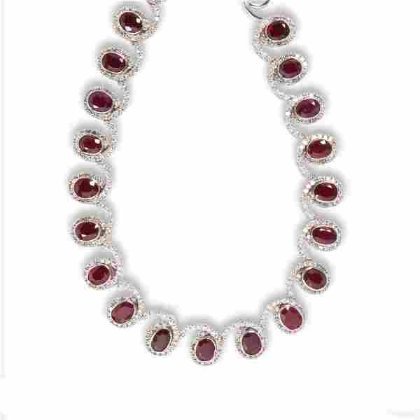 A ruby, diamond and eighteen karat white gold necklace
