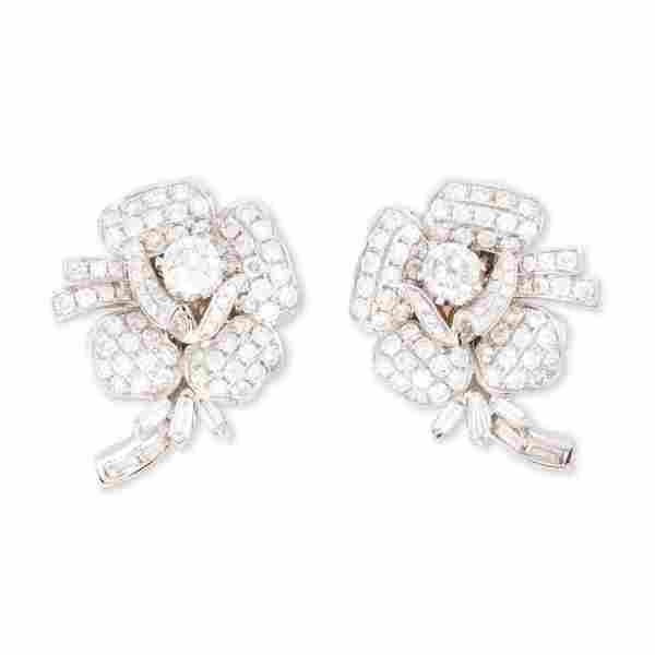 A pair of diamond and eighteen karat white gold
