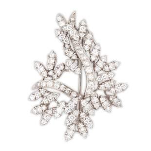 A diamond and fourteen karat white gold brooch