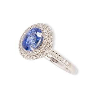 A Ceylon sapphire, diamond and platinum ring