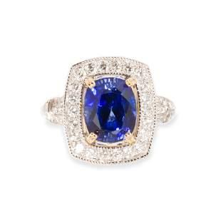 A sapphire, diamond and fourteen karat white gold ring