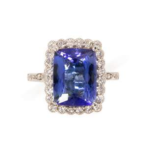 A tanzanite, diamond and eighteen karat white gold ring