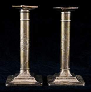 A Tiffany & Co. sterling weighted candlesticks