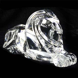 A Steuben figural sculpture of a recumbent lion,