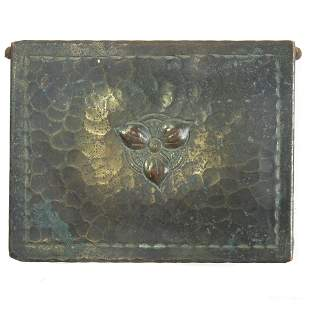 An Arts & Crafts hammered copper box