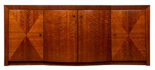 A highly figured four door marquetry decorated buffet