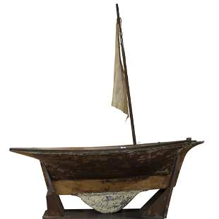 A bench made sailboat model, 19th century, retains
