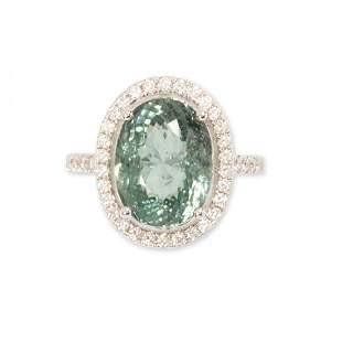 A greenish blue tourmaline, diamond and eighteen karat