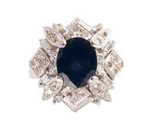 A sapphire, diamond and eighteen karat white gold ring