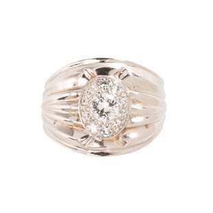 A diamond and fourteen karat white gold ring