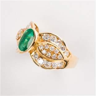 An emerald, diamond and eighteen karat gold ring