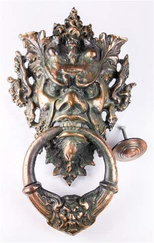 Baroque style copper Bacchanilian mask form door