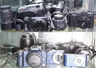 (lot of 15) Cameras: Leica, 3 Nikon; and 5 Lumix
