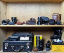 Two shelves of vintage cameras lenses and equipment