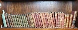 Two shelves of leather bound books