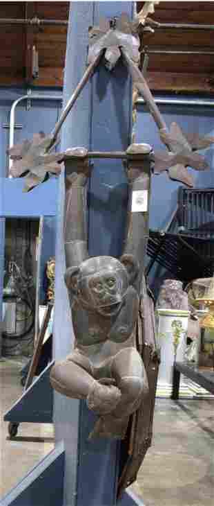 A Mexican Folk Art monkey form sculpture