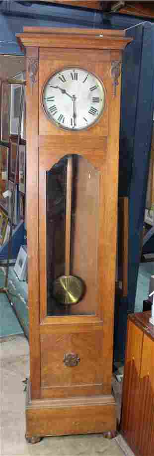 An Arts and Crafts quartersawn oak tall case clock